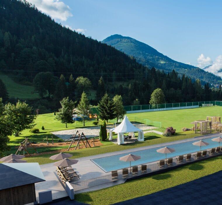 Hofgut-Wagrain-Apartment-Lifestyle-Resort-Erleben-im-Hofgut-fuer-Kinder-Aussenanlage-Fussballplatz